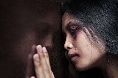 Young Aboriginal girl crying