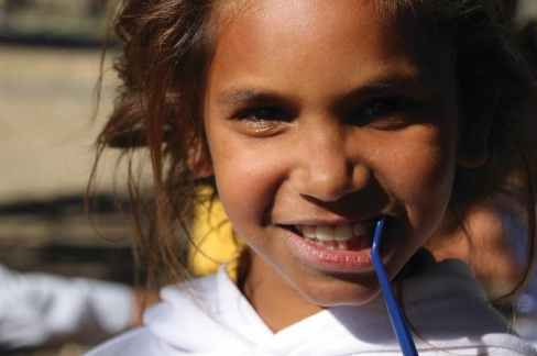 Aboriginal girl with toothbrush in her mouth