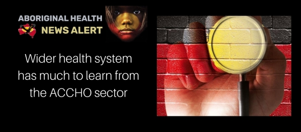 Feature title - Aboriginal hand holding stethoscope painted on brick wall in Aboriginal flag colours