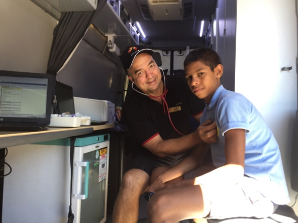 Aboriginal teenager having heart check in mobile health truck