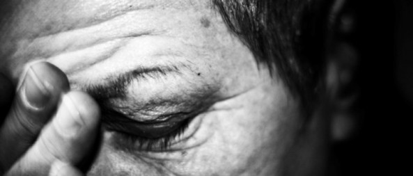 close up image of Aboriginal woman's hand pressed to her face