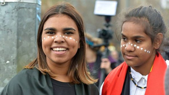 two Aboriginal teenage girls with white dot paint across their faces