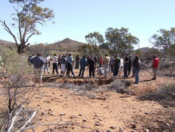 large group of Aboriginal men on country undertaking ADAC training