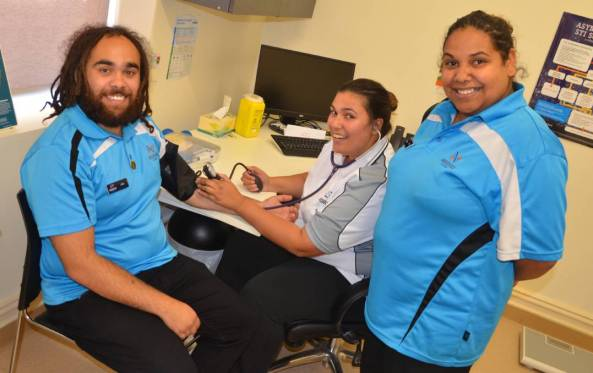3 Moorundi ACCHS Aboriginal Health Workers in office, one have blood pressure taken
