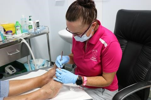 allied health professional treating patient's feet