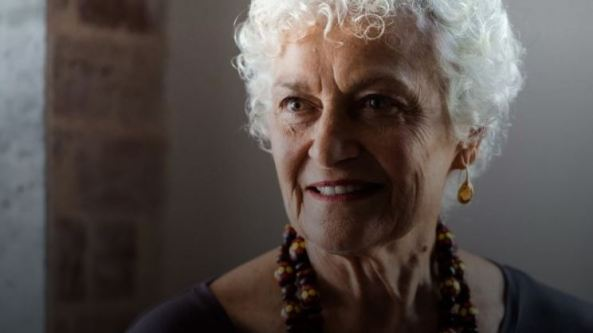 portrait image of Professor Fiona Stanley, short grey curly hair, Aboriginal coloured beads