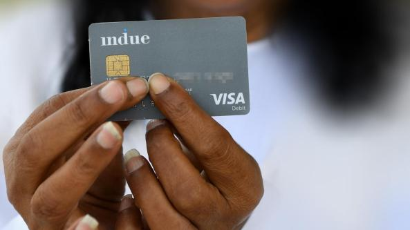 Aboriginal hands holding the cashless debit card