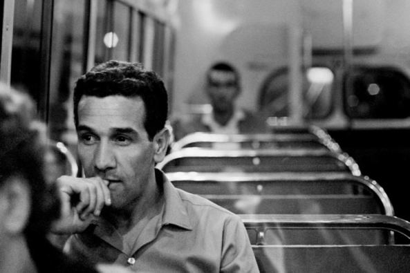 black and white photo of Charles Perins on bus home after visit to Tranby, Glebe 1963