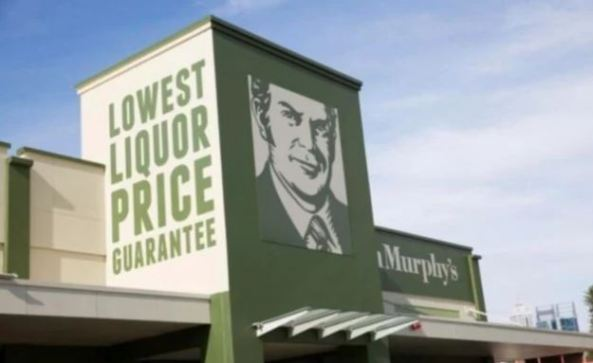 Dan Murphy's lowest liquor price guarantee signage of outside of store