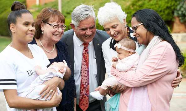 Minister Wyatt, two researches & two Aboriginal mums and bubs