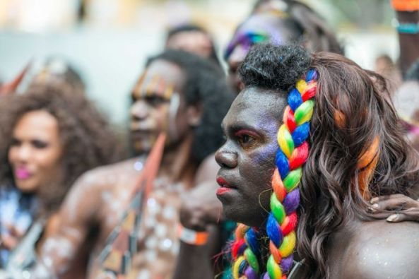 Aboriginal trans person with rainbow coloured plait