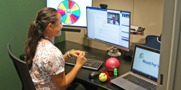 health professional at desk conducting telehealth session