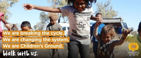 children's ground banner - 7 Aboriginal children running towards camera on country