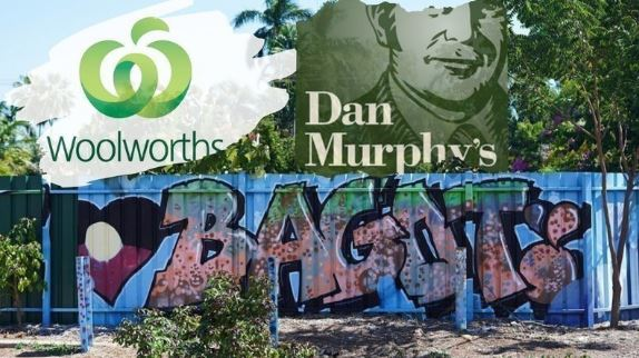 shipping container with spray painted Aboriginal flag heart & word Bagot, superimposed with logos for Woolworths and Dan Murphy's