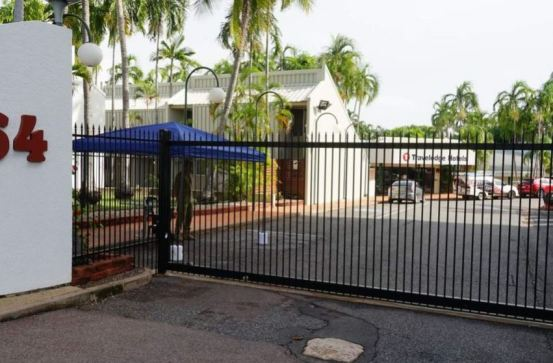 external view of Travelodge Hotels Darwin, front gate closing, Australian soldier standing guard