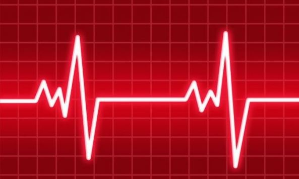 red background of graph & white lines of a heart beat
