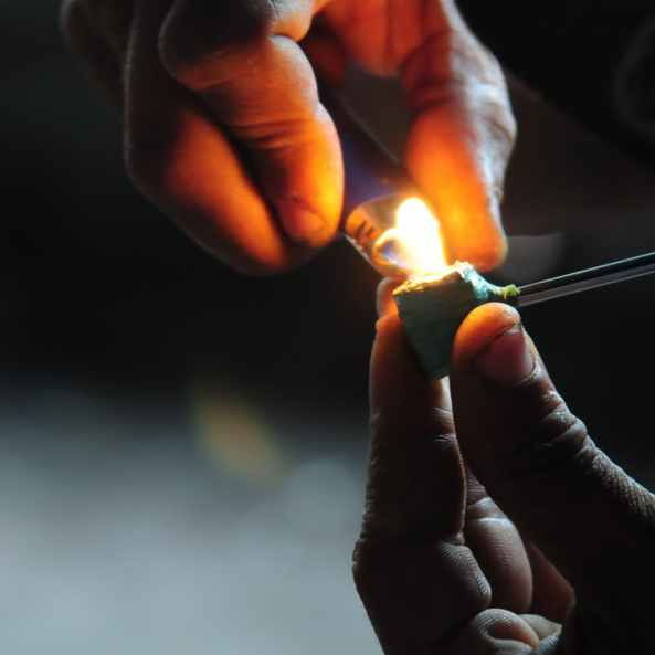 hands lighting an ICE pipe