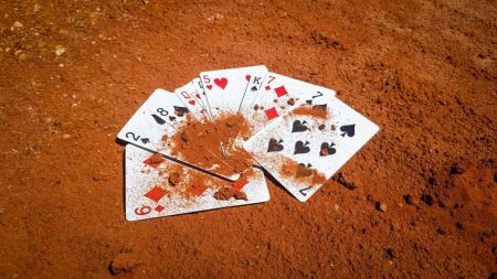 playing cards in red dust
