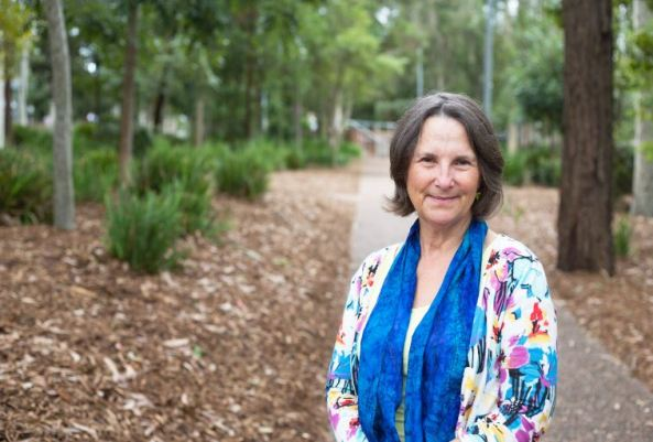 Associate Professor Gillian Gould standing on tree lined path