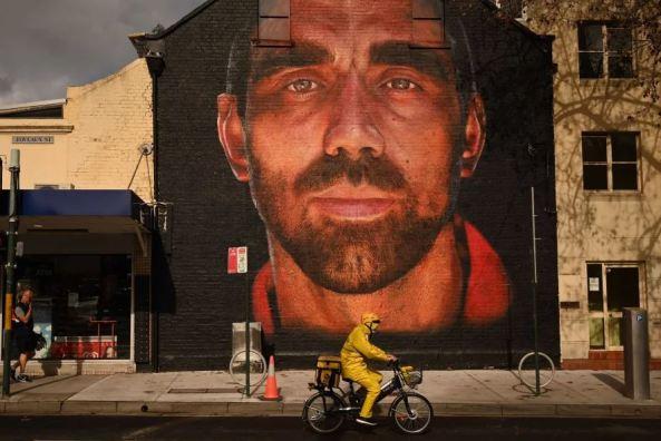 brick wall mural of Adam Goodes