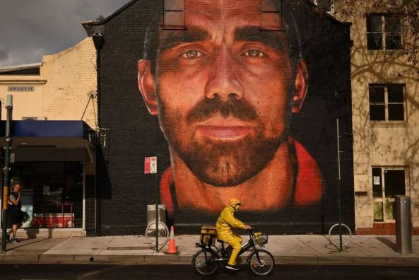 brick wall mural of Adam Goodes