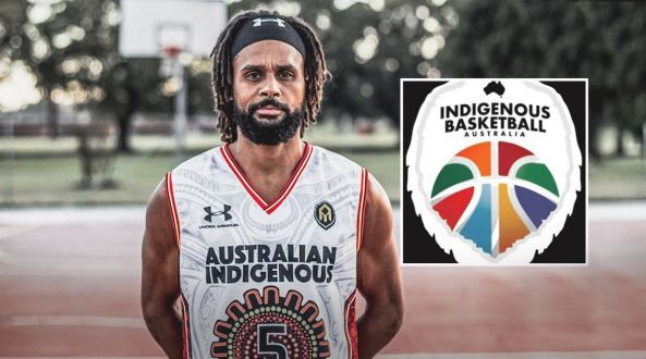 Aboriginal Basketballer Patty Mills in basketball kit with blurred background of a basketball court & the Indigenous Basketball Australia logo superimposed