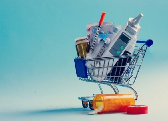 shopping trolley medical products, pills, needles, vials, thermometer etc.